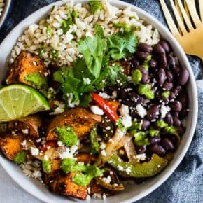 These sweet potato black bean burrito bowls are the perfect vegetarian meal to add to your weekly meal plan. Delicious cilantro lime rice piled high with black beans, roasted sweet potatoes, and vegetables. Trust me, you'll go crazy over this bowl!