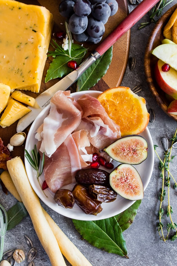 This fall harvest cheese board is the perfect combo of flavorful cheeses, Italian meats, dried fruits, fresh fruits and crispy crunchy crackers. If you have ever been intimidated about putting together a cheese board I have you covered with step by step instructions!