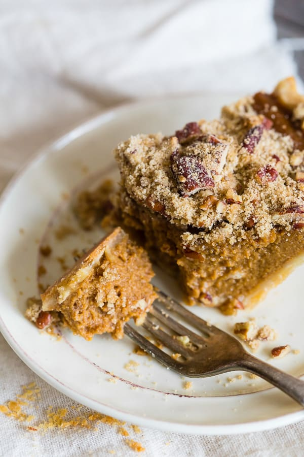 This streusel topped apple butter pumpkin pie is the perfect addition to your holiday dessert spread. It's the perfect twist to traditional pumpkin pie and the crumbly streusel topping is packed full of spice.