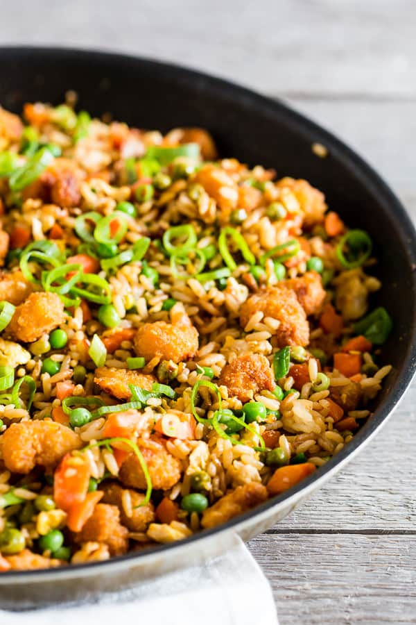 This crispy shrimp fried rice is the perfect busy weeknight meal. Crispy baked shrimp mixed together with a homemade vegetable and egg filled fried rice. Plus it's ready in just 20 minutes! How easy is that?