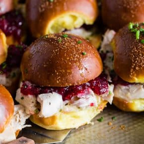 These baked cranberry cheddar turkey sandwiches are the perfect use for your leftover Thanksgiving turkey and cranberry sauce. What's not to love about delicious potato rolls topped with Thanksgiving leftovers?