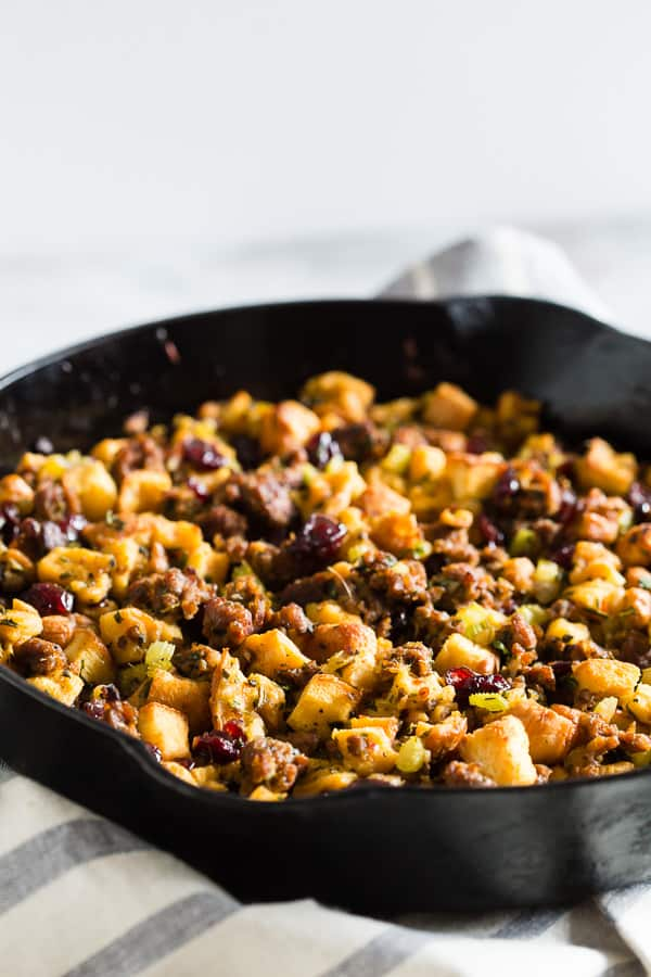 This potato bread sausage cranberry stuffing is the perfect addition to your Thanksgiving table. Made with soft potato bread, Italian sausage, tons of fresh herbs and dried cranberries. You'll love how easy this is to throw together and how delicious it tastes!