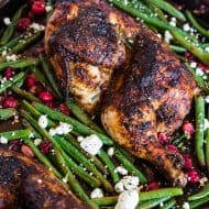 This sheet pan cranberry balsamic chicken and green beans is the perfect holiday meal for two. Chicken halves marinated in a cranberry balsamic sauce and served with roasted green beans, fresh cranberries, and goat cheese.
