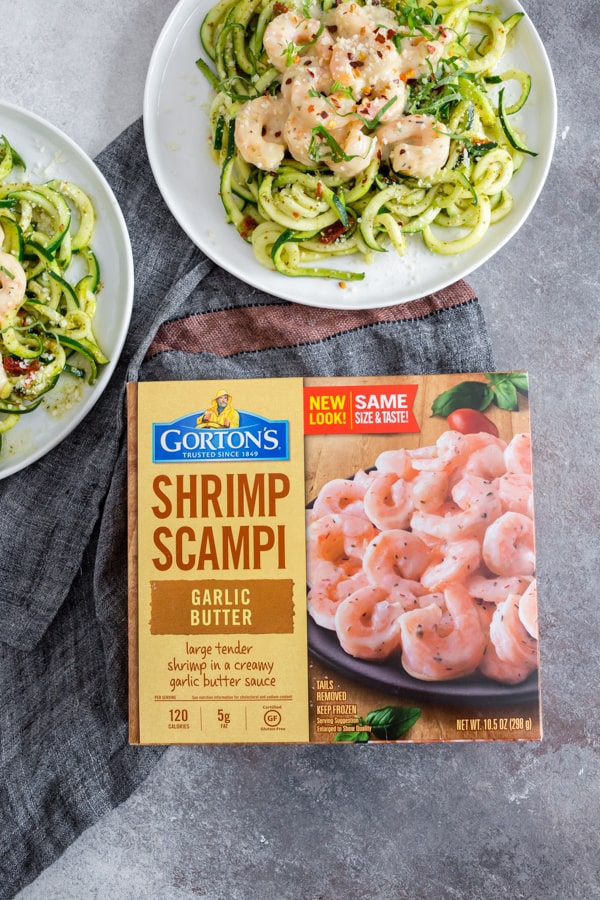 These garlic shrimp pesto zoodles are the perfect quick and easy weeknight meal. Spiralized zucchini tossed in pesto and topped with creamy garlic butter shrimp. You're going to love this recipe!