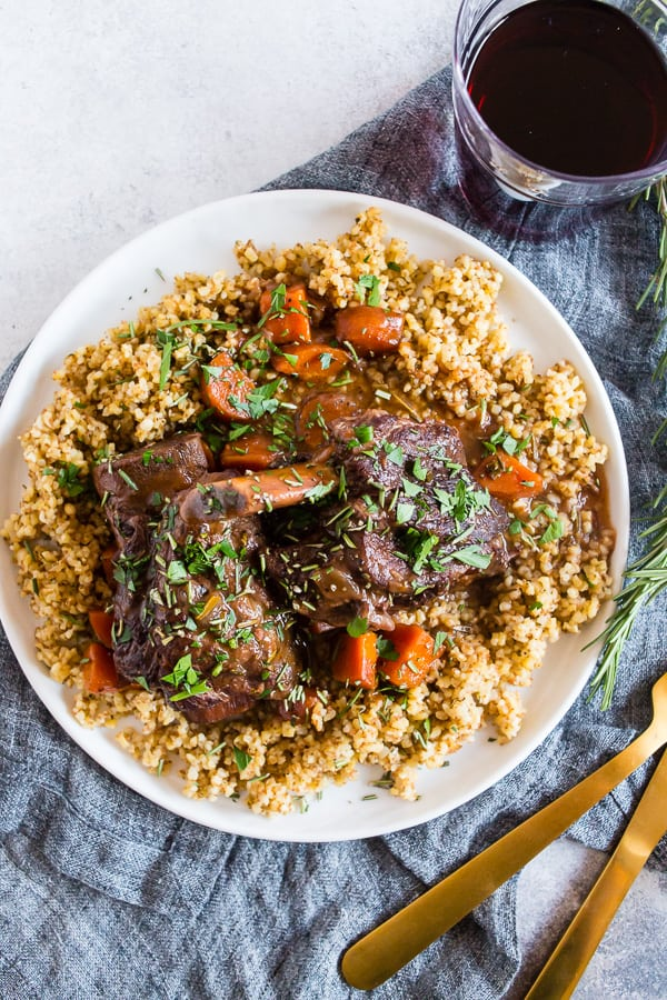 These instant pot red wine rosemary short ribs are the perfect use of your electric pressure cooker. They turn out perfectly tender and are packed full of red wine and rosemary flavor. They are even better when served with ancient grains and drizzled with red wine gravy.