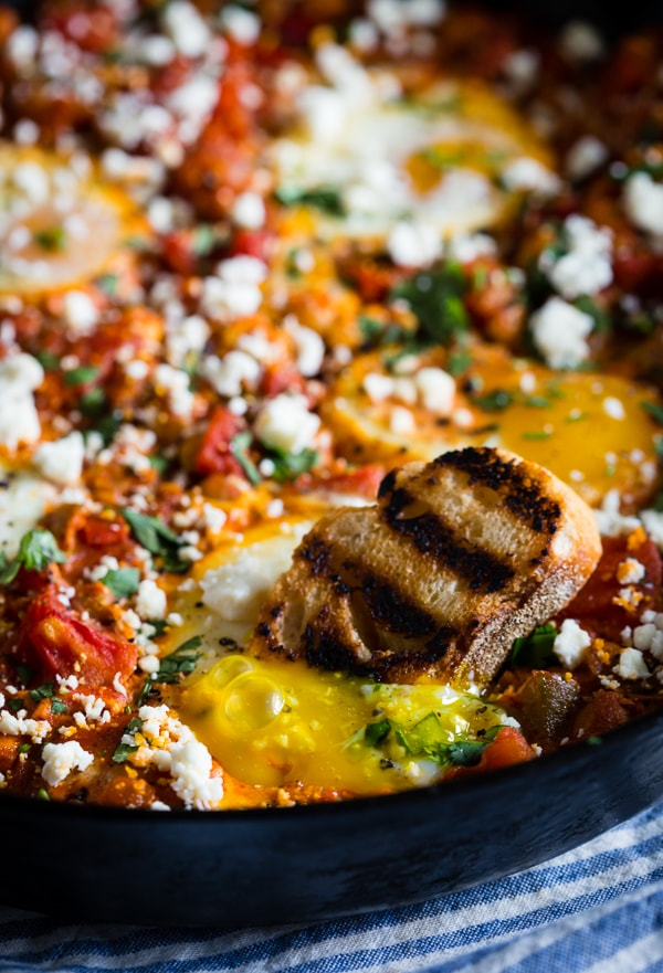 This feta chickpea shakshuka is the perfect breakfast, brunch or dinner recipe. It's packed full of protein and flavor and ready in just 35 minutes! Plus, it reheats beautifully and perfect when paired with crusty grilled bread.