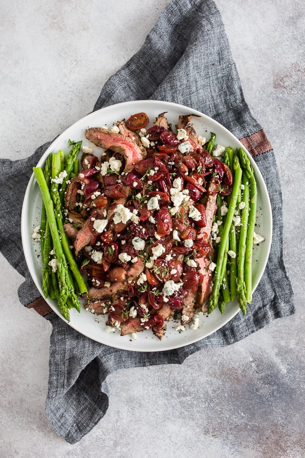 This grape and blue cheese flank steak is the perfect romantic meal and it's ready in JUST 30 minutes! Herb marinated flank steak cooked on the stovetop and topped with balsamic sautéed grapes and shallots and sprinkled with blue cheese - what's not to love?