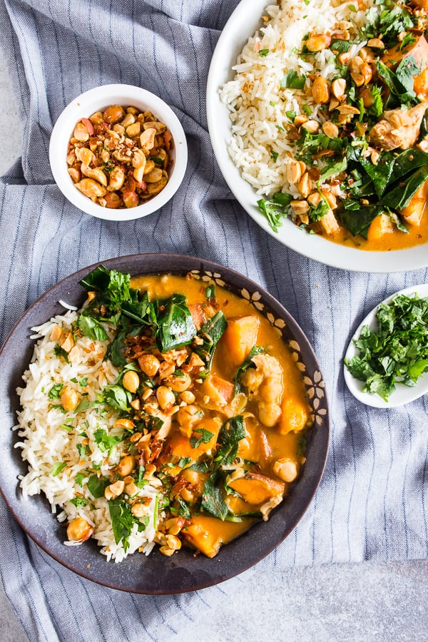This African chicken peanut stew is packed full of chicken thighs, sweet potatoes, chickpeas, and collard greens simmering in a flavorful peanut butter and chicken stock broth. It's deliciously spicy and best served over rice and sprinkled with cilantro and crushed peanuts. This dish is hearty, full of flavor and ready in under an hour.