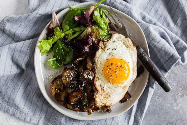 This garlic wild mushrooms on toast is a flavorful way to start your day. Perfectly toasted sourdough bread covered with sauteed mushrooms with garlic and herbs and topped with a fried egg. It's super flavorful and makes a great breakfast, lunch or dinner.