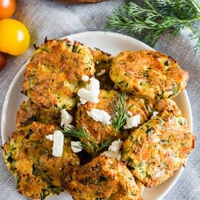 These Greek zucchini fritters are the perfect appetizer and vegetable filled dipper. Made with shredded zucchini, feta cheese and lots of fresh herbs. You'll love how easy they are to make and how easy they are to devour!