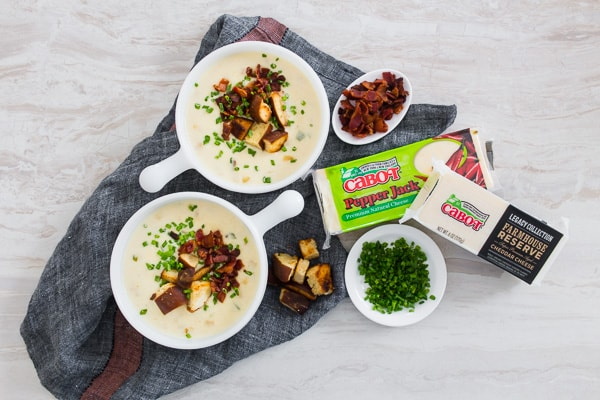 This spicy sharp cheddar beer soup is the perfect cheesy soup you need for cold spring nights. It's slightly spicy with the addition of fresh jalapeno and pepper jack cheese with just the right splash of beer flavor and sharp cheddar. Perfect when topped with homemade soft pretzel croutons, fresh chives, and crispy bacon.