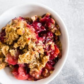 This cardamom vanilla plum crisp is filled with juicy plums and topped with a crunchy oatmeal hazelnut topping. It's the perfect sweet treat to end the day with a perfect hint of vanilla bean and cardamom flavor.