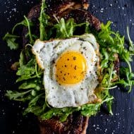 This fried egg topped steak is your breakfast or dinner of your dreams. Deliciously seasoned steak grilled and then topped with a lightly dressed arugula salad and a super crispy around the edges fried egg. This is the type of dish you'll devour and dream about!