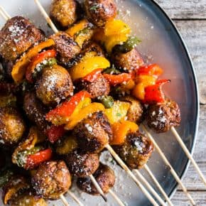 These grilled chicken meatball and peppers skewers are the perfect grilling kebab dinner. Made easy with store bought meatballs and fresh chopped bell peppers with a mix of herbs and oil. Sprinkle with Parmesan cheese for a delicious finish!