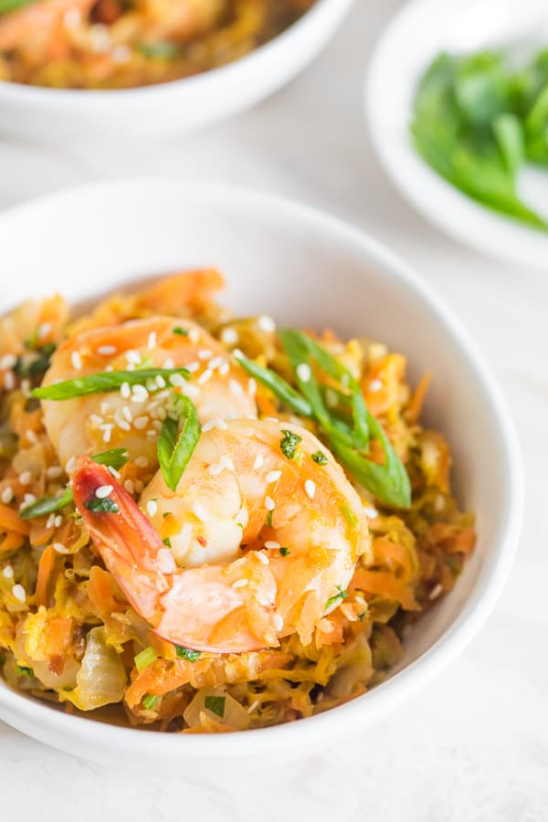 This spicy shrimp egg roll skillet is the quick and easy weeknight meal you need! It's packed full of napa cabbage, carrots, garlic, ginger, and spicy shrimp. It's ready in just 30 minutes and packed full of flavor!