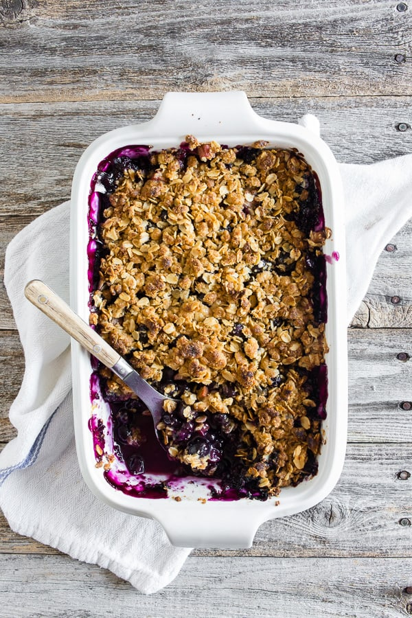This blueberry rhubarb crisp is the perfect way to celebrate the bounty of summer. Sweet blueberries paired with tart rhubarb and topped with a crunchy rolled oat topping. It's delicious eaten warm and even better when topped with ice cream or whipped cream.