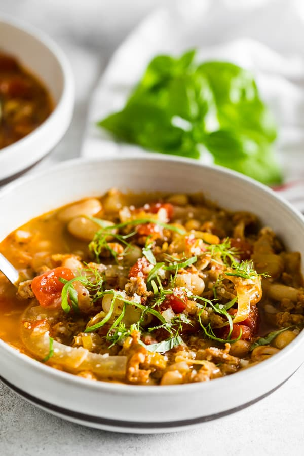 This Italian sausage fennel white bean soup is the perfect cool night soup. Packed with hot Italian sausage, flavorful fennel, white beans and lots of fresh basil. You'll love all the flavor you get packed in this easy to throw together soup.