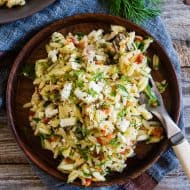 This Mediterranean tuna orzo salad is a great quick and easy weeknight meal. Protein packed tuna and orzo pasta mixed with lemon, capers, artichoke hearts, sundried tomatoes and lots of fresh herbs. You'll love this easy summertime meal!