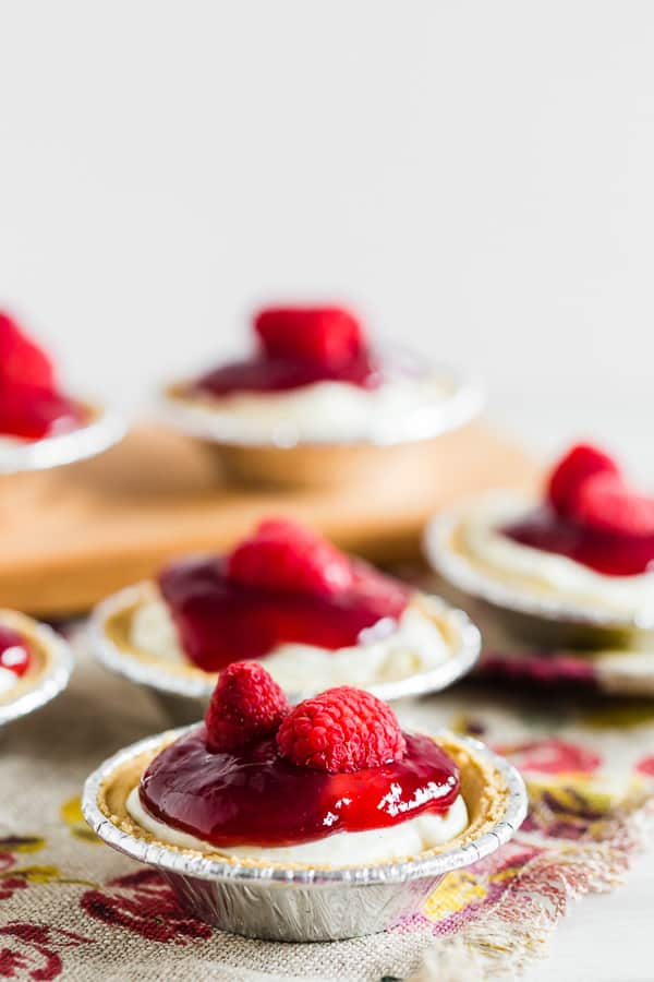 These no bake raspberry lemon mini cheesecakes are going to be your new favorite summer dessert. Lots of big time lemon flavor packed into a creamy cheesecake mixture and topped with raspberry jam and fresh raspberries. It's the perfect mixture of sweet and tart!