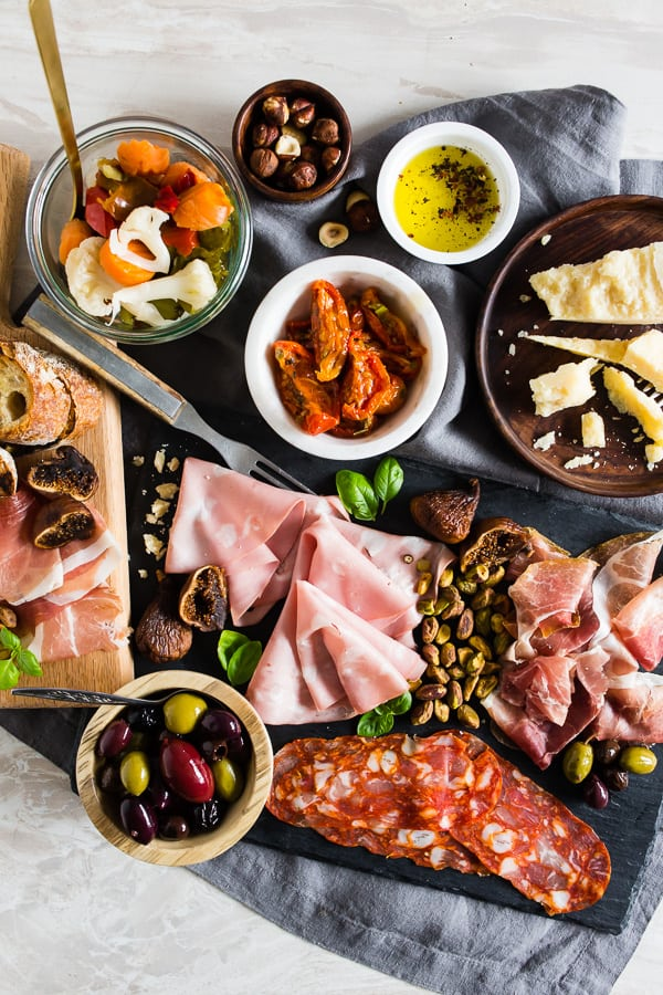 This Italian salumi board is the perfect combination of delicious imported Italian meats, imported Italian cheese, nuts, dried fruit, olives, roasted tomatoes, pickled vegetables and grilled bread. It makes a great appetizer or a simple summer meal - no cooking required!