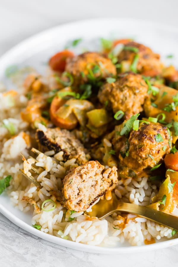 These red curry turkey meatballs are packed full of flavor and come together in no time for a quick weeknight meal. You can even make the meatballs in advance to make the meal come together even quicker!