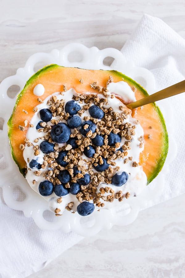 This crunchy yogurt cantaloupe breakfast bowl is the perfect no-cook breakfast that is full of flavor, fresh summer fruit and protein all topped with crunchy Grape Nuts cereal. You're going to love this quick and easy summertime breakfast bowl.