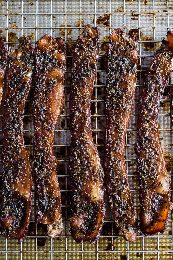 This maple black pepper bacon is the perfect balance of sweet and savory. Eat it as a midday snack or sneak a few bites as a midnight snack. Made with maple syrup, maple sugar and a lot of fresh cracked black pepper. You'll love these crispy little bites.