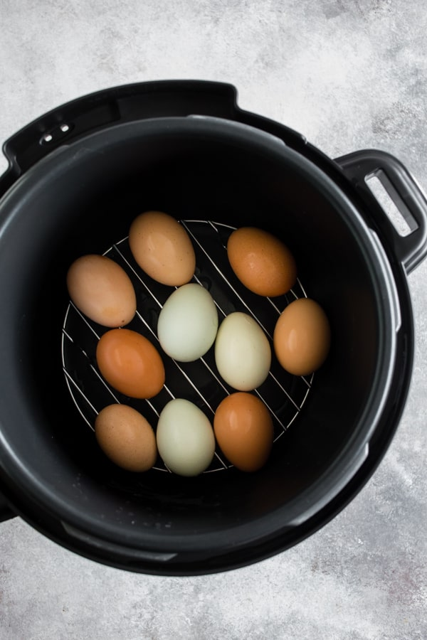 These pressure cooker hard boiled eggs turn out perfect every single time! The best part is that they peel easily without sticking to the white of the egg. Eat them plain, sprinkle with seasoning or throw them in a salad - these eggs can do it all!