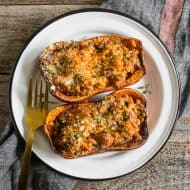 This stuffed honeynut squash is filled with Italian sausage, mushrooms, spinach and just a touch of Parmesan cheese. You'll love how simple it is to make this dish and love the sweet natural flavor of honeynut squash.