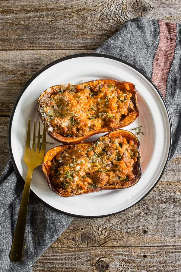 stuffed honeynut squash on a plate