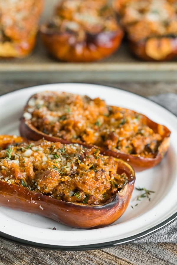 stuffed honeynut squash on served on a white ceramic plate