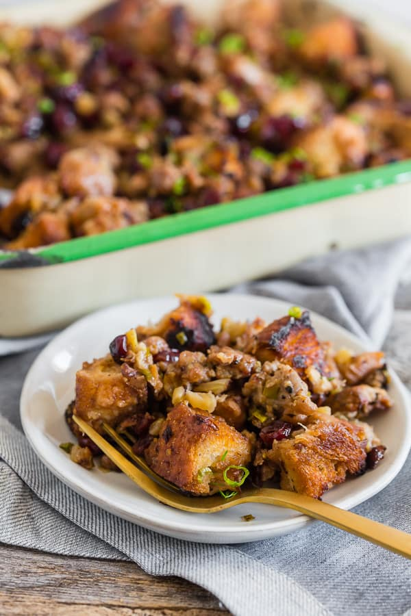 This Texas toast stuffing is full of garlic bread Texas toast, spicy and sweet turkey Italian sausage, fennel, green onions, and dried cranberries. It's a fun twist to traditional stuffing that is packed full of flavor and super simple to make.