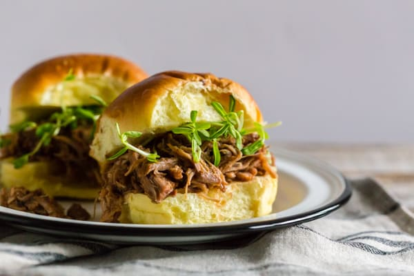 This pressure cooker cranberry sauce pulled pork is the perfect way to use up any leftover holiday cranberry sauce. It's the perfect combination of spicy ginger beer, sweet cranberry sauce, tart fresh cranberries, fresh herbs, and fresh pork. It's great on a sandwich or served over rice.
