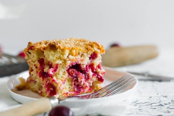 This vanilla cranberry buttermilk cake is the perfect Christmas cake. Full of fresh cranberries, vanilla beans, orange zest and a sprinkle of turbinado sugar on top for an extra special sparkly surprise. You'll love how easy it is to make this tasty breakfast or dessert treat!