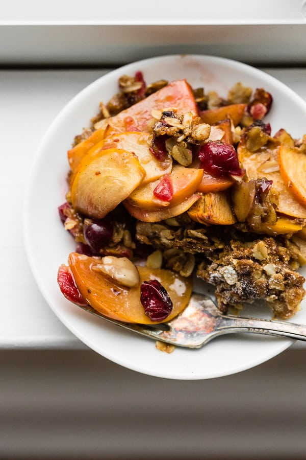This vanilla persimmon crisp is the perfect holiday dessert. It's made with thinly sliced seasonal persimmons, chopped fresh cranberries, vanilla bean paste and topped with a homemade vanilla oat and almond mixture. You'll love this simple winter dessert!
