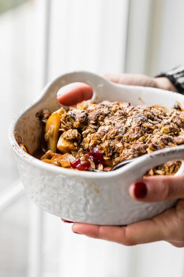 This vanilla bean persimmon crisp is the perfect holiday dessert. It's made with thinly sliced seasonal persimmons, chopped fresh cranberries, vanilla bean paste and topped with a homemade vanilla oat and almond mixture. You'll love this simple winter dessert!