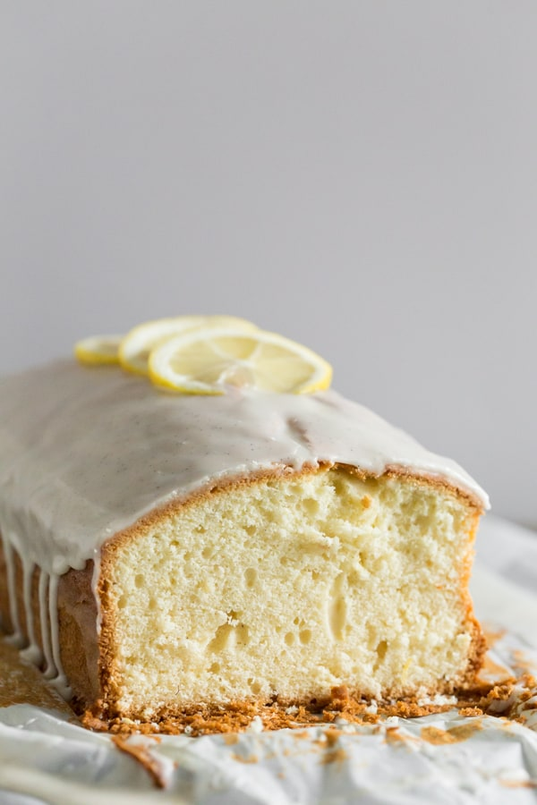 This lemon vanilla pound cake is the perfect winter dessert. It's packed full of fresh lemon zest and vanilla beans and topped with a thick and creamy pound cake glaze. All you need to do is grab and fork and a hot cup of coffee and dig in!
