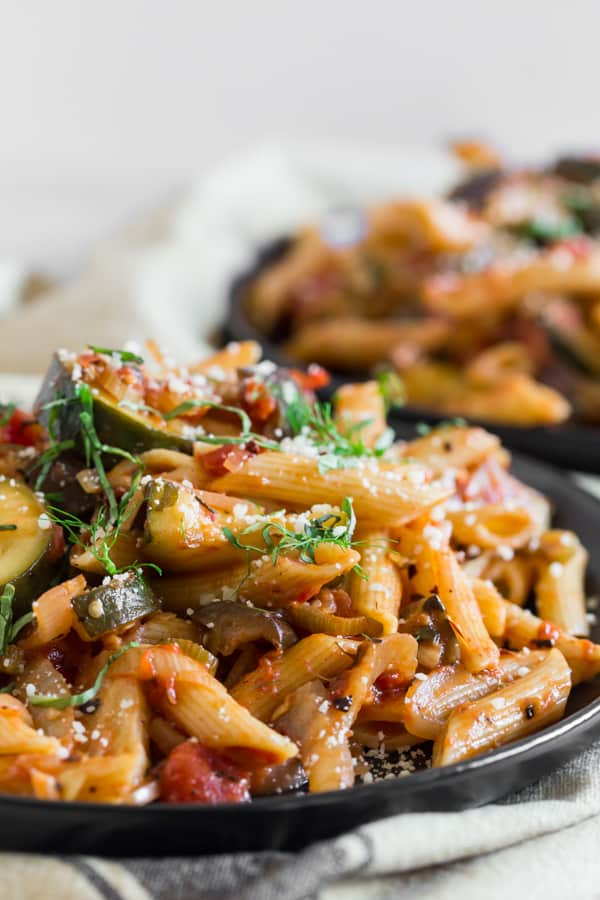 This ratatouille pasta is full of zucchini, eggplant, onions, fennel and tomatoes. So delicious and ready in no time!