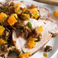 This roast pork loin with dried fruit compote is an easy and flavorful dinner recipe that your whole family will love. Serve with rice, buttered noodles or even mashed potatoes. Juicy roast pork served with a homemade compote made out of golden raisins, dried apricots, dates, orange juice and just a touch of cilantro. So good!