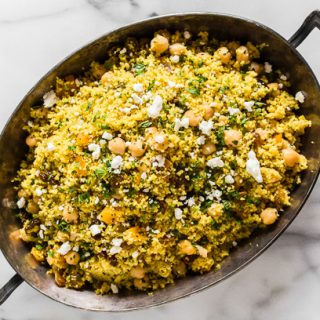 This Moroccan couscous with chickpeas is flavored with ras el hanout, golden raisins, dried apricots, and fresh herbs. It's the perfect side dish that packs a punch in the flavor department. Trust me, you'll love this dish!