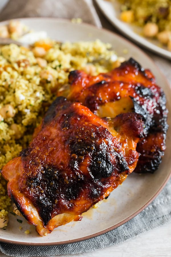 These harissa chicken thighs are spicy, sweet and PACKED full of flavor. They are baked on a sheet pan and come out super crispy. If you love that spicy and sweet combination these chicken thighs are for you!
