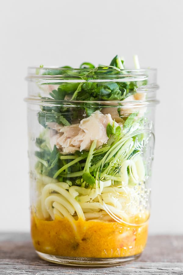 This homemade cup of noodles is the perfect on the go lunchtime meal. It's made up of a homemade chicken soup base, fresh greens, cooked noodles, roasted chicken and fresh herbs. Just add boiling water and you'll have lunch in minutes!