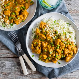 This Instant Pot Chicken Tikka Masala is a flavorful addition to your weekly menu. It's packed with tender chicken swimming in a thick and spice filled tomato coconut milk based sauce with peas served over basmati rice. Super simple to make and packed full of flavor!