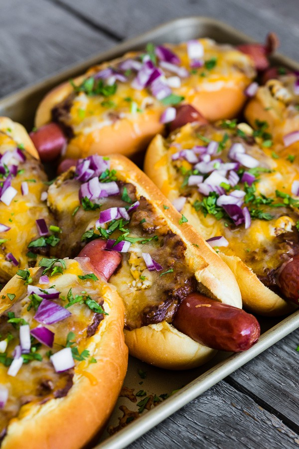 These oven baked chili cheese dogs are the perfect game day treat. Made on a sheet pan and then baked until hot and melty.