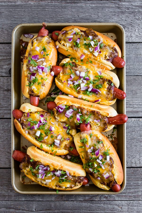 These oven baked chili cheese dogs are the perfect party treat. Made right on a sheet pan and then oven baked until hot and melty.