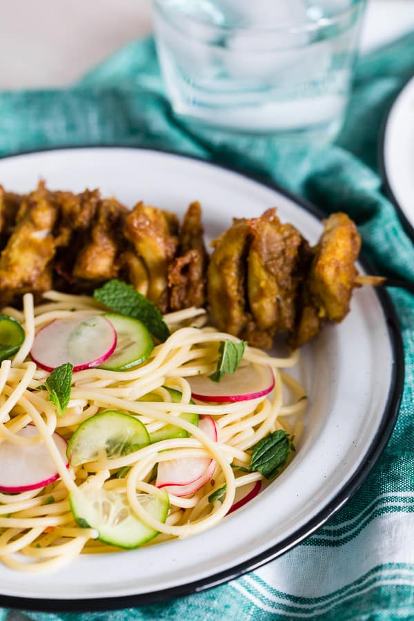 These chicken satay noodles give you all the flavor of takeout but in a homemade dish that will leave you feeling full and satisfied. Peanut butter marinated chicken skewers served with a homemade noodle salad that tastes just like traditional Thai cucumber sauce. You'll love this light and flavorful dish that is perfect for warm spring days!