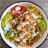 These chipotle shrimp fajita bowls are a quick weeknight dinner option that will make the whole family happy. It's full of flavorful chipotle lime shrimp that are served over rice with sauteed vegetables and drizzled with a cilantro lime Greek yogurt sauce. It's super simple and can be made in just 30 minutes!
