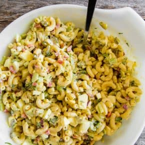 This classic macaroni salad is packed full of crunchy vegetables, hard-boiled eggs, and a homemade dressing made out of yellow mustard, mayonnaise, and pickle juice. It's the perfect old fashioned Easter side dish or a delicious summertime cookout addition.