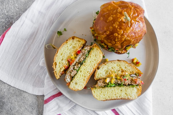 These chipotle chicken burgers are topped with fiery pepper jack cheese and fresh homemade mango salsa. Trust me, this burger is packed full of flavor and the perfect addition to your summer BBQ.