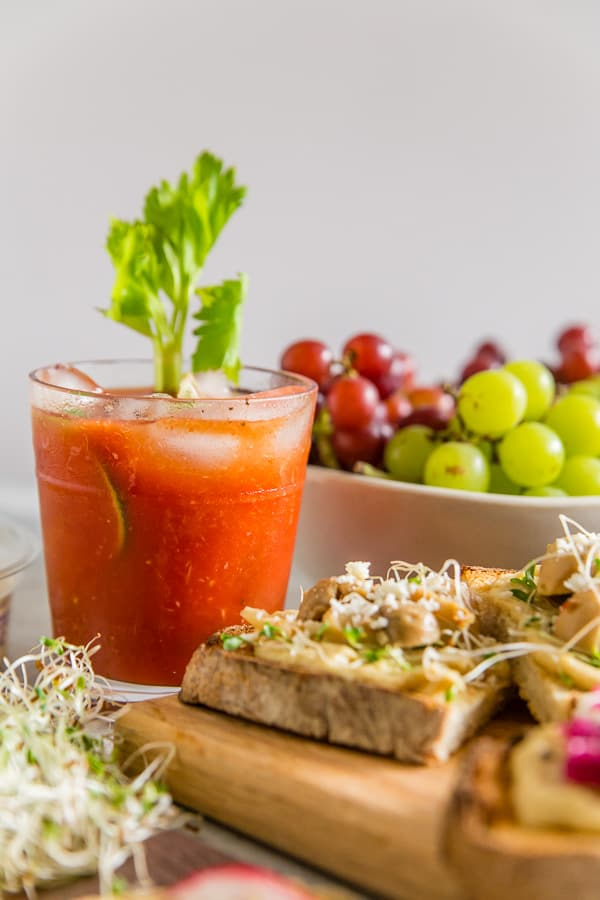 This horseradish bloody mary is slightly spicy, packed full of flavor and the perfect addition to any party or this tasty hummus toast brunch bar. Plus it's ready in just 5 minutes so it's the perfect party cocktail!